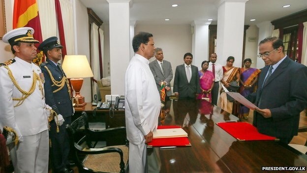 Chief Justice Sripavan taking his oaths before President Maithripala Sirisena