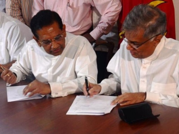 UNP Leader Ranil Wickremesinghe and Rajitha Senaratne, Leader of the UPFA break-away group sign the MOU Agreement for the new United Front United National Front formed for good governance ahead of Parliamentary Elections in Sri Lanka